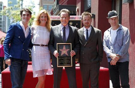 Actor Bryan Cranston (C) poses with co-stars from his series ''Breaking Bad'' (L-R) RJ Mitte, Anna Gunn, Aaron Paul and Bob Odenkirk during ceremonies to unveil his star on the Hollywood Walk of Fame in Hollywood July 16, 2013. REUTERS/Fred Prouser