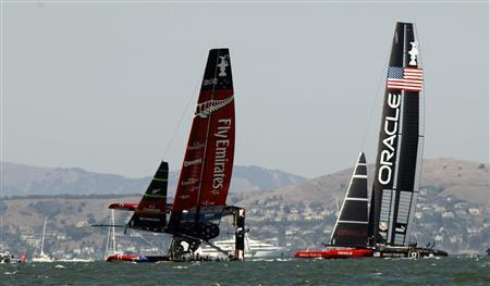 Emirates Team New Zealand (L) sails on one hull against Oracle Team USA during Race 8 of the 34th America's Cup yacht sailing race in San Francisco, California September 14, 2013. REUTERS/Robert Galbraith