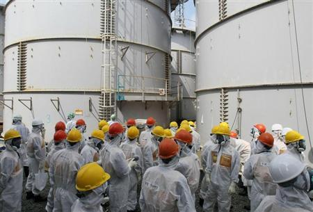 Members of a Fukushima prefecture panel, which monitors the safe decommissioning of the nuclear plant, inspect a contaminated water tank (C, in the back) which leaked radioactive water at the H4 area of the contaminated water storage tanks, at Tokyo Electric Power Co. (TEPCO)'s tsunami-crippled Fukushima Daiichi nuclear power plant in Fukushima in this September 13, 2013, photo released by Kyodo. REUTERS/Kyodo