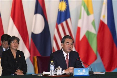 Chinese Foreign Minister Wang Yi addresses the opening session of the ASEAN -China Foreign Ministers meeting at the Diaoyutai State Guesthouse in Beijing August 29, 2013. REUTERS/Adrian Bradshaw/Pool