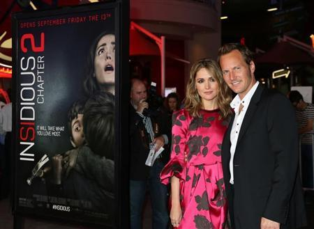 Actors Rose Byrne and Patrick Wilson arrive for the premiere of their new film ''Insidious: Chapter 2'' in Los Angeles, California September 10, 2013. REUTERS/Fred Prouser