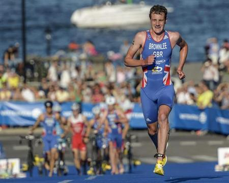 Britain's Alistair Brownlee runs on his way to winning the ITU World Triathlon elite race for men in Stockholm City August 25, 2013. REUTERS/Janerik Henriksson/Scanpix Sweden