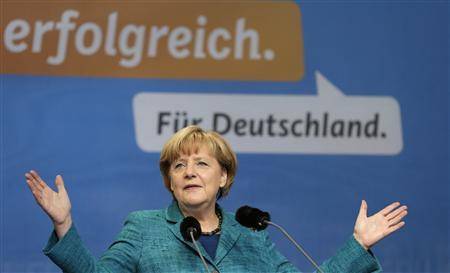 German Chancellor and head of the Christian Democratic Union party (CDU) Angela Merkel delivers a speech at a CDU election campaign event in Dresden September 15, 2013. German voters will take to the polls in a general election on September 22. Part of the sentence in the background reads:''Successful. For Germany''. REUTERS/Tobias Schwarz