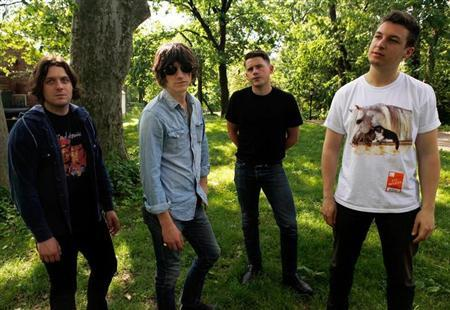 Members of the Arctic Monkeys (L-R) Jamie Cook, Alex Turner, Nick O'Malley and Matt Helders pose for a portrait in New York's Central Park May 24, 2011. REUTERS/Jessica Rinaldi/Files