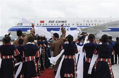 Local Tibetans wave hada, or traditional silk scarves, as they greet the first group of passengers who landed at Daocheng Yading Airport in Daocheng county of Garze Tibetan Autonomous Prefecture, Sichuan province September 16, 2013. The airport, at 4,411 metres (14,472 feet) above sea level, surpassed the Qamdo Bangda Airport which has an altitude of 4,334 metres (14,219 feet), and became the highest airport in the world after its inauguration on Monday, according to local media. REUTERS/China Daily