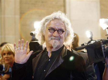 Cast member Billy Connolly waves at the premiere of ''Fido'' at the Ryerson theatre during the 31st Toronto International Film Festival in Toronto September 7, 2006. The festival runs from September 7 until the 16. REUTERS/Mario Anzuoni