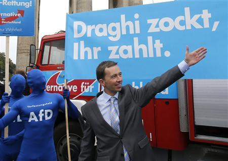 Bernd Lucke, the leader of the euro-critical Alternative for Germany party (AFD) gestures in front of a campaign poster during an election campaign rally in Berlin September 16, 2013. REUTERS/Fabrizio Bensch