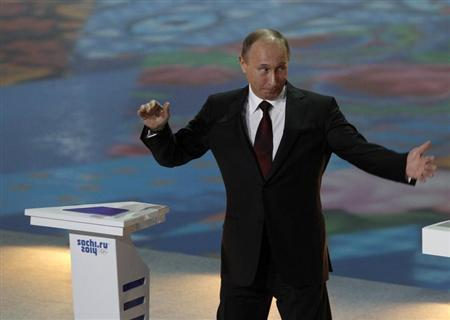 Russian President Vladimir Putin gestures during a ceremony to launch a countdown clock for the 2014 Winter Olympics in the Bolshoi Ice Dome in the Black Sea resort of Sochi February 7, 2013. REUTERS/Sergei Karpukhin