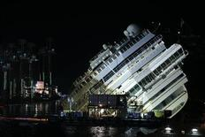 "The capsized cruise liner Costa Concordia lies on its side during the ""parbuckling"" operation next to Giglio Island. REUTERS/Tony Gentile"