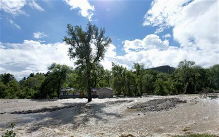 A home with floodwater from Left Hand Creek running on both sides is seen in Boulder, Colorado September 16, 2013. REUTERS-Mark Leffingwell