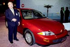 File photo of Toyota Motor Corporation's honorary chairman Eiji Toyoda introducing a Toyota Cavalier compact car.