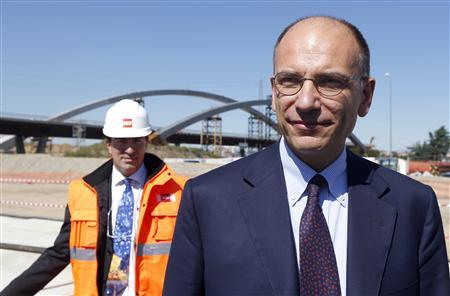 Italian Prime Minister Enrico Letta arrives at the construction site of Expo 2015, on the outskirts of Milan, September 13, 2013. REUTERS/ Stefano Rellandini