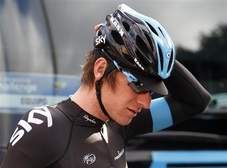 Tour de France and Olympic time trial champion Bradley Wiggins of Britain gestures before the start of the 4th stage of the Challenge tour of Mallorca in Alcudia on the Spanish Balearic island of Mallorca, February 6, 2013. REUTERS/Enrique Calvo