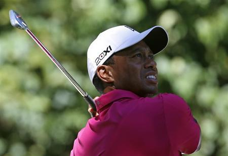 Tiger Woods of the U.S. hits from the second tee during the third round of the BMW Championship golf tournament at the Conway Farms Golf Club in Lake Forest, Illinois, September 14, 2013. REUTERS/Jim Young