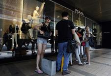 Mainland Chinese customers line up outside a Prada store at Hong Kong's shopping Tsim Sha Tsui district September 16, 2013, one day before the Hong Kong-listed Italian fashion label announces its 2013 first-half results in the territory. REUTERS/Bobby Yip
