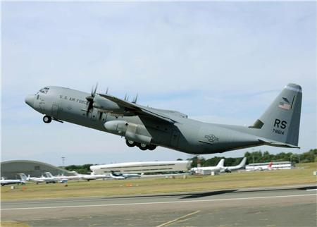 A C-130J Super Hercules takes off from the Farnborough Aerodrome runway July 19, 2010, in Farnborough in this U.S. Air Force handout photo. REUTERS/U.S. Air Force/Staff Sgt. Jerry Fleshman/Handout
