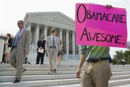 Supporters of the Affordable Healthcare Act gather in front of the Supreme Court before the court's announcement of the legality of the law in Washington on June 28, 2012 in this file picture. REUTERS/Joshua Roberts