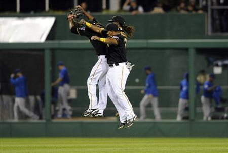 Pittsburgh Pirates' Felix Pie, Andrew McCutchen (R) and Marlon Byrd (front) celebrate their victory over the Chicago Cubs after their National League MLB baseball game in Pittsburgh, Pennsylvania September 14, 2013. REUTERS/David DeNoma