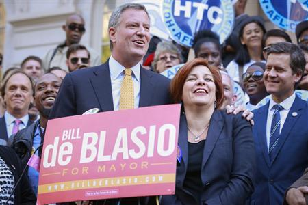 New York City Democratic mayoral nominee Bill de Blasio (L) embraces former mayoral candidate and City Council Speaker Christine Quinn during a news conference receiving her endorsement at City Hall in New York September 17, 2013. REUTERS/Shannon Stapleton