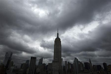 Storm clouds pass over the top of the Empire State Building in New York, June 13, 2013. REUTERS/Lucas Jackson