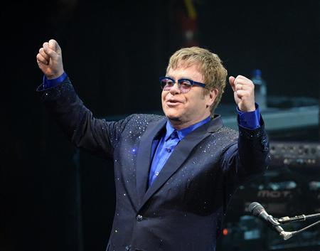 Musician Elton John performs songs off his new album ''The Diving Board'' with USC Thornton School of Music students in Los Angeles, California on September 16, 2013. REUTERS/Kevork Djansezian/Files