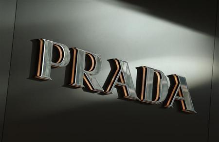 Sunlight is reflected on a Prada logo outside its store at Hong Kong's shopping Tsim Sha Tsui district September 16, 2013, one day before the Hong Kong-listed Italian fashion label announces its 2013 first-half results in the territory. REUTERS/Bobby Yip
