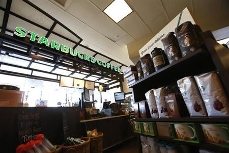Coffee packages are pictured on display at a Starbucks Coffee store in Pasadena, California July 25, 2013. REUTERS/Mario Anzuoni