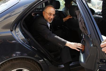 Iran's former Foreign Minister Ali Akbar Salehi reacts upon his arrival to attend the official opening ceremony for the new headquarters of the Iranian embassy in Amman, May 7, 2013. REUTERS/Majed Jaber