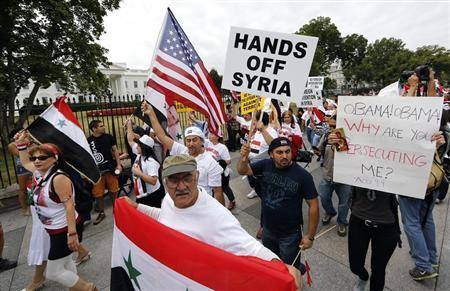 Syrian-American demonstrators march against U.S. military intervention in Syria in front of the White House in Washington, September 9, 2013. REUTERS/Jim Bourg