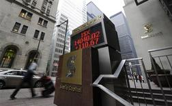 A man walks past an electronic board displaying the midday TSX index in Toronto February 16, 2011. REUTERS/Mark Blinch