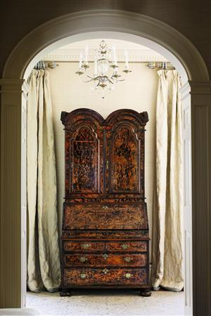 Sotheby's New York handout picture shows an important Queen Anne brass-inlaid stained burr maple and yewwood desk-and-bookcase attributed to Coxed and Woster circa 1715 from The Collection of Niki & Joe Gregory in this image released to Reuters on September 17, 2013. REUTERS/Sotheby's New York/Handout via Reuters