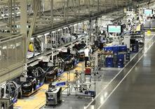 Volkswagen employees work on the assembly line of the 2012 VW Passat in Chattanooga Tennessee, December 1, 2011. REUTERS/Billy Weeks