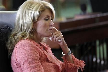 Texas state Democratic Senator Wendy Davis listens as the state Senate meets to consider legislation restricting abortion rights in Austin, Texas July 12, 2013. REUTERS/Mike Stone