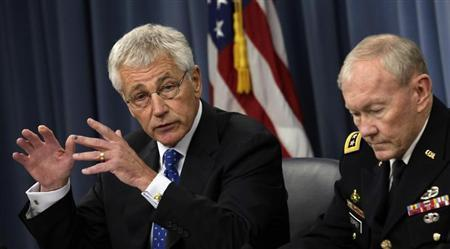 U.S. Secretary of Defense Chuck Hagel (L) and Chairman of the Joint Chiefs of Staff General Martin Dempsey speak at a joint news conference at the Pentagon in Washington September 18, 2013. REUTERS/Yuri Gripas