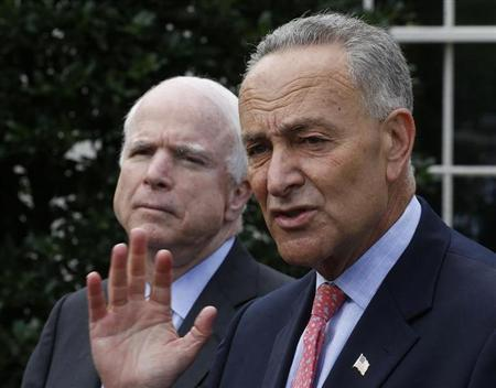 U.S. Senators Charles Schumer (D-NY), R, and John McCain (R-AZ) speak to the media after meeting with U.S. President Barack Obama about immigration reform in Washington July 11, 2013. REUTERS/Larry Downing