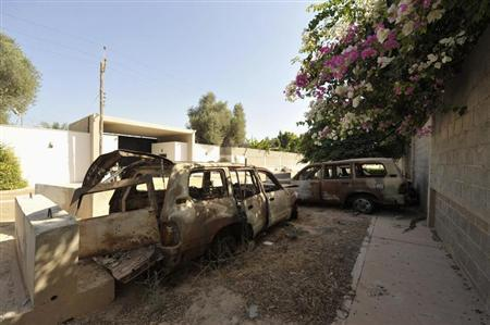 The remnants of cars from an attack on the U.S. Consulate, which killed U.S. Ambassador Christopher Stevens, are seen near the wall of the consulate in Benghazi, September 11, 2013, on the first anniversary of the attack. REUTERS/Esam Omran Al-Fetori