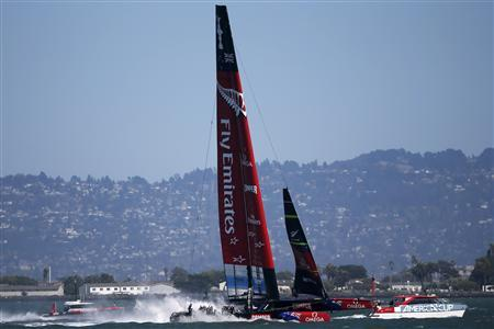 Emirates Team New Zealand sails in San Francisco Bay after the postponement of Race 11 of the 34th America's Cup yacht sailing race against Oracle Team USA in San Francisco, California September 17, 2013. REUTERS/Stephen Lam