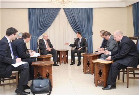 Syria's President Bashar al-Assad (centre, on R) meets Russian deputy Foreign Minister Sergei Ryabkov (centre, on L) in Damascus, in this handout photograph distributed by Syria's national news agency SANA on September 18, 2013. REUTERS/SANA/Handout via Reuters