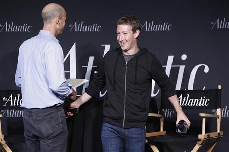Facebook CEO Mark Zuckerberg (R) takes his seat for an onstage interview for with James Bennet (L) of the Atlantic Magazine in Washington, September 18, 2013. REUTERS/Jonathan Ernst