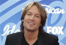 "American Idol judge and country music star Keith Urban arrives at the Season 12 finale of ""American Idol"" in Los Angeles, Calfiornia in this file photo taken May 16, 2013. REUTERS/Jonathan Alcorn/Files"