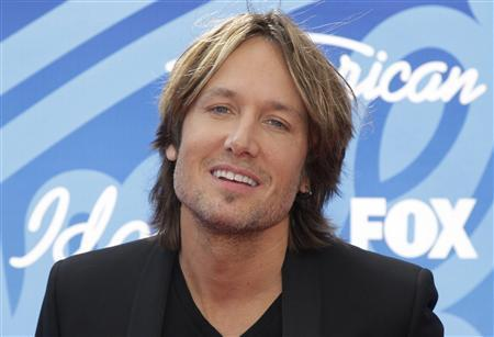 American Idol judge and country music star Keith Urban arrives at the Season 12 finale of ''American Idol'' in Los Angeles, Calfiornia in this file photo taken May 16, 2013. REUTERS/Jonathan Alcorn/Files