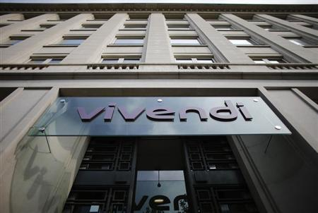 A logo of entertainment-to-telecoms conglomerate Vivendi is seen on the main entrance of the company's headquarters in Paris July 23, 2013. REUTERS/Christian Hartmann