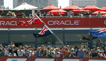 Fans of Emirates Team New Zealand cheer after their team defeated Oracle Team USA during Race 11 of the 34th America's Cup yacht sailing race in San Francisco, California September 18, 2013. REUTERS/Robert Galbraith