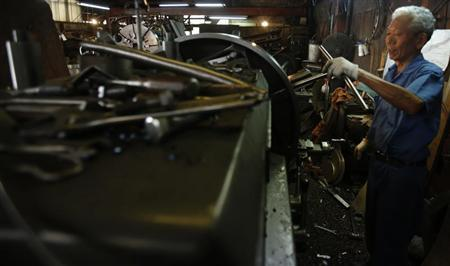 A man works inside a factory in Tokyo August 12, 2013. REUTERS/Yuya Shino