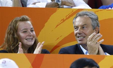 Former British Prime Minister Tony Blair and his daughter Kathryn cheer British track cyclists at the Beijing 2008 Olympic Games, August 19, 2008. REUTERS/Jacky Naegelen