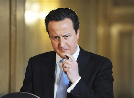 Britain's Prime Minister David Cameron listens to a question during a news conference at Number 10 Downing Street in London March 14, 2013. REUTERS/Nick Ansell/pool