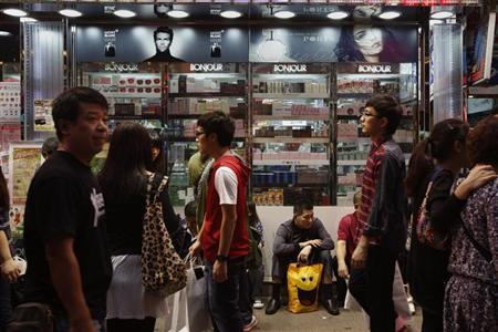 A mainland Chinese tourist rests outside a cosmetic store in Mong Kok district in Hong Kong, October 4, 2011. REUTERS/Bobby Yip