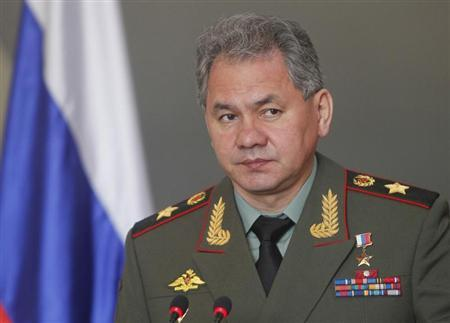Russia's Defence Minister Sergei Shoigu speaks in front of the Russian flag while attending a news conference after a meeting with his Vietnamese counterpart Phung Quang Thanh (not pictured) in Hanoi March 5, 2013. REUTERS/Kham