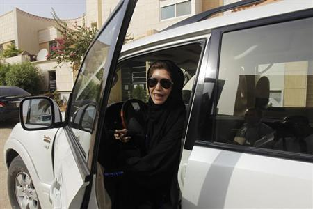 Female driver Azza Al Shmasani alights from her car after driving in defiance of the ban in Riyadh June 22, 2011. REUTERS/Fahad Shadeed