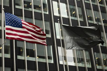 A U.S. and JPMorgan flag fly in front of the headquarters of JPMorgan Chase & Co bank in New York, March 15, 2013. REUTERS/Lucas Jackson